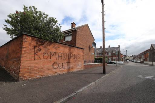 racist attacks romanians belfast